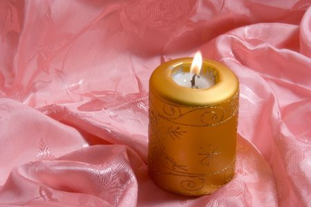 Candle on a pink background photo