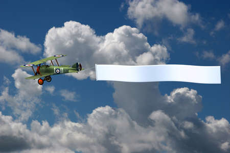 3D render of a biplane pulling a blank banner. The background is a photograph photo