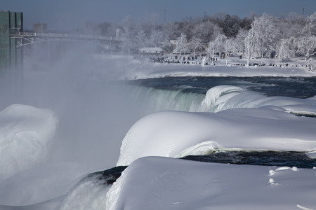 reveals: A Niagara Falls overlook on the American side reveals a winter wonderland. A little grain can be seen in the upper distance. Stock Photo