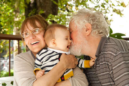 grandparents: Grandparents having great fun with their grandchild Stock Photo