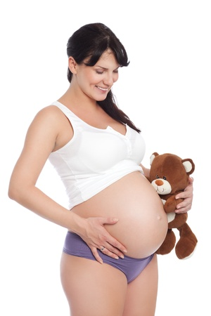 Image of nine month pregnant young woman, isolated on white photo