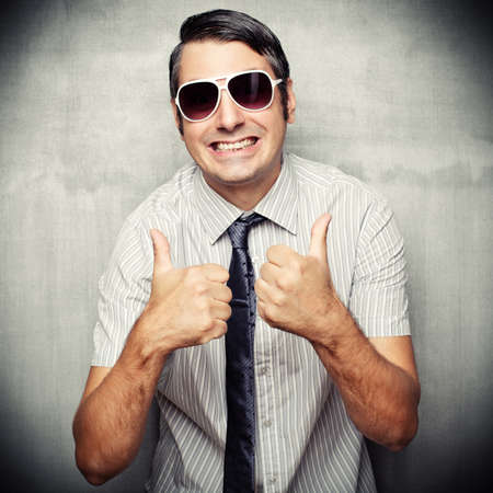 short sleeved: Image of nerd in short sleeved shirt and sunglasses giving a thumbs up