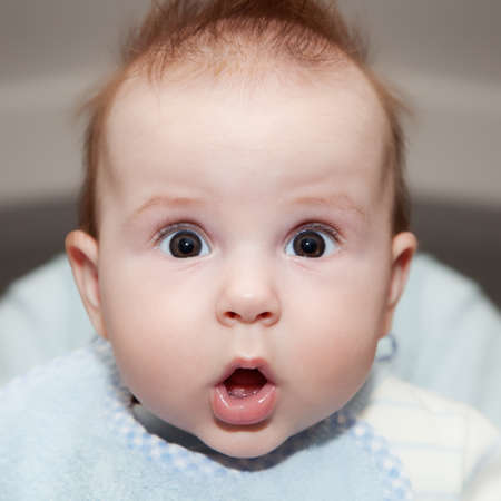 infants: Cute 4 months old baby making a funny surprised face