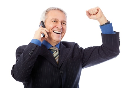 Image of senior businessman getting good news by phone, isolated on white