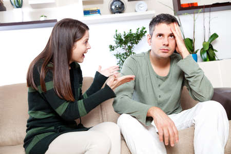 couple arguing: Image of young couple having quarrel Stock Photo