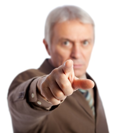 beckon: Senior businessman pointing at camera, isolated on white