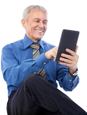 palmtop computer: Image of senior businessman using digital tablet, isolated on white