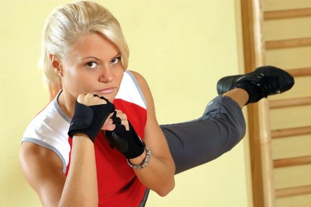 Young attractive woman, excercising in gym photo
