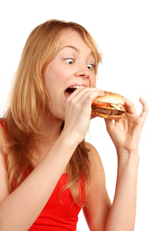Young girl eating hamburger, isolated on white Stock Photo