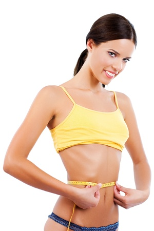 teen girl underwear: Young woman measuring her waist and smiling
