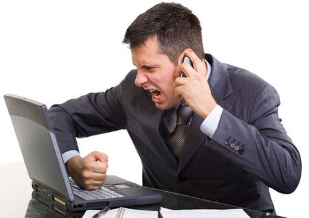 angry businessman: Young caucasian man in a suite, with a phone and laptop screaming and shouting , isolated on white