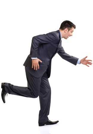 handsom: Young funny caucasian man in suit running, isolated on white
