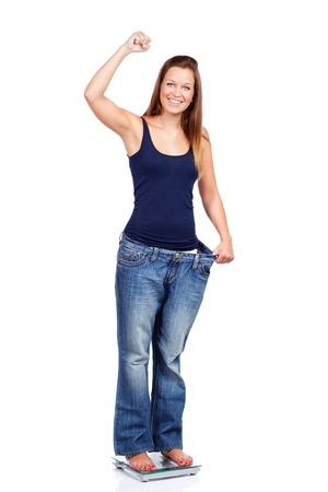 Young woman delighted with her dieting results, isolated on white Stock Photo