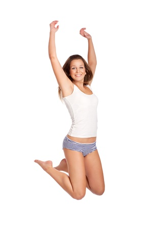 Beautiful young woman jumping, isolated on white photo