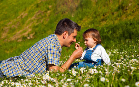 pick: Father and son picking flowers and having fun on meadow