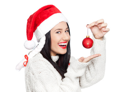 Image of beautiful young woman holding Christmas decoration ball, isolated on white photo