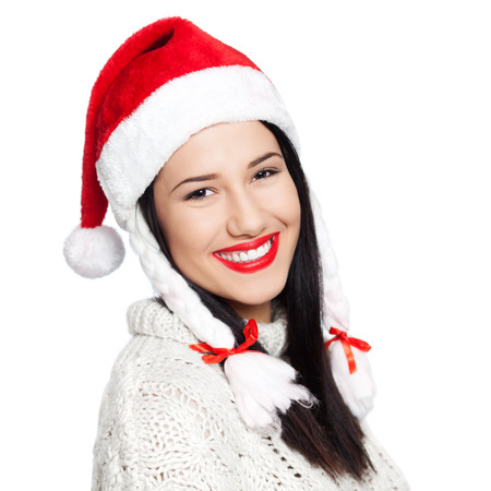 Portrait of beautiful young woman wearing Santa's hat, isolated on white photo