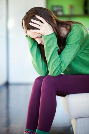 young woman having a headache photo