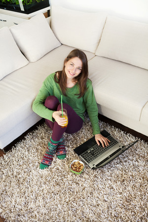 long socks: Image of beautiful young woman relaxing at home with laptop