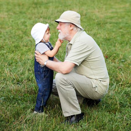grandchild: Grandchild pulling his grandfathers beard Stock Photo