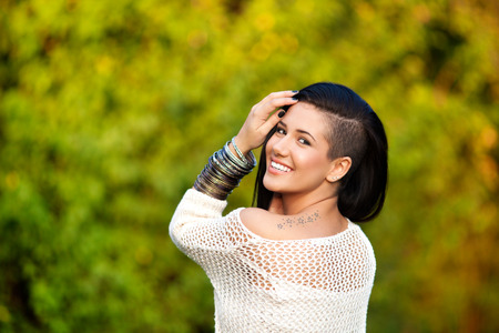bracelet tattoo: Portrait of beautiful young woman smiling Stock Photo