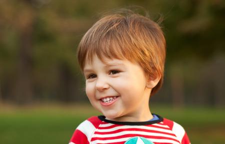 ��beautiful boy�: Portrait of beautiful boy smiling, shallow depth of field Stock Photo