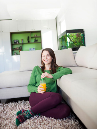 long socks: Portrait of a beautiful young woman relaxing at home