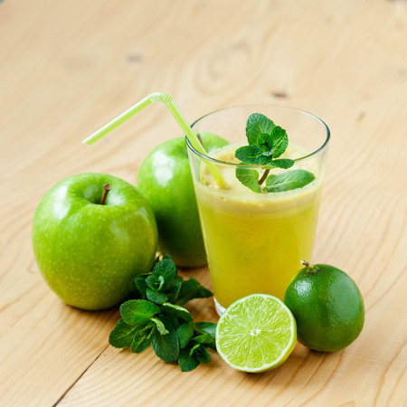 field mint: A glass of fresh apple, lime and mint juice, shallow depth of field Stock Photo