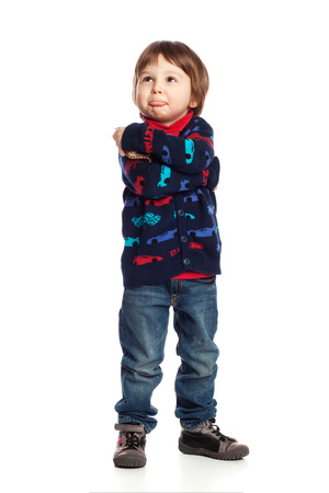 brat: A boy with arms crossed pretending to be unhappy, isolated on white Stock Photo