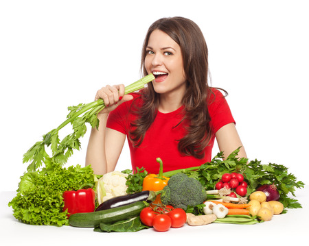 celery: Young woman with vegetables eating celery, isolated on white