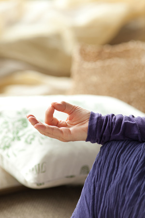 Lotus position, close up on hand, shallow depth of field Stock Photo