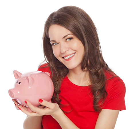 thrift box: Woman holding piggy bank, isolated on white Stock Photo