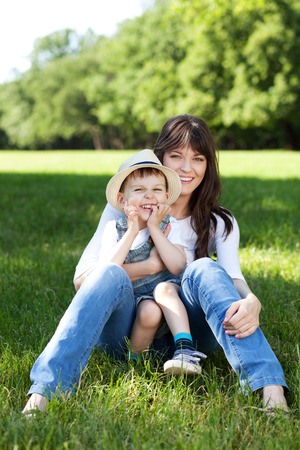 family tickle: Mother and son having fun outdoors Stock Photo
