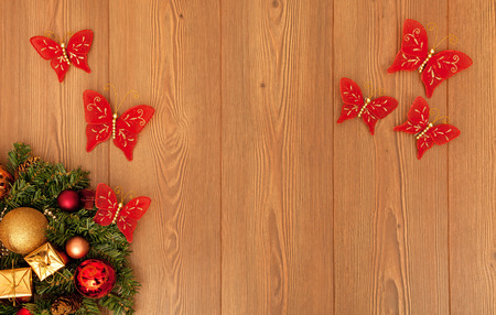 Christmas decorations with Christmas tree branch on wooden background photo