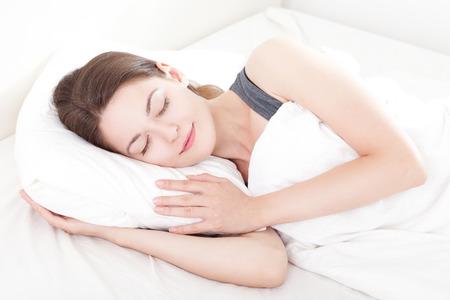 wellness sleepy: Beautiful young woman asleep, on white background Stock Photo