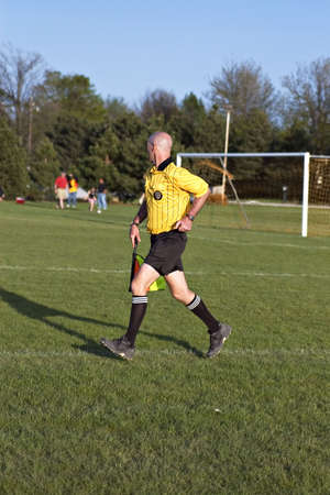 Soccer official running to keep up with the play Stock Photo - 904935