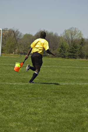 Soccer Official running with flag  Stock Photo - 904939
