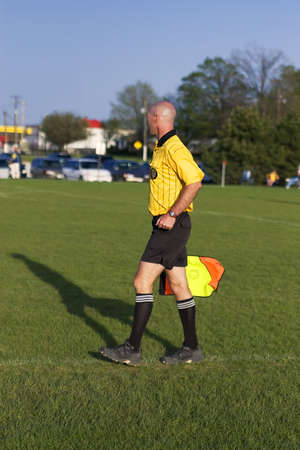 Soccer official at a late afternoon soccer game Stock Photo - 910311