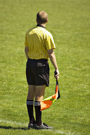 Soccer official at a soccer game with a flag Stock Photo - 910312