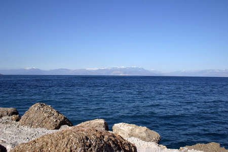 horizont: Sea view with rocks on front and mountains on the horizont line.