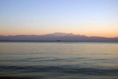 horizont: Lonely ship at the horizont. Stock Photo