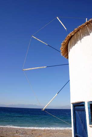 cycladic: Cycladic tipo mulino a vento sul mare.
