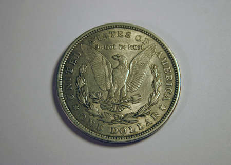 pluribus: Old one US dollar coin.