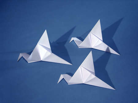origami paper: Three origami paper birds on blue