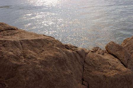 atmospheric: Coastline rocks detail with atmospheric lighting Stock Photo