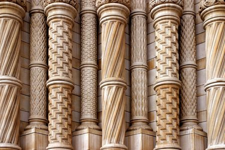 eclectic: Eclectic stone columns with different rich geometric patterns Stock Photo