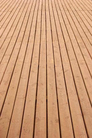 tectures: Wooden planks floor fading away to the horizon