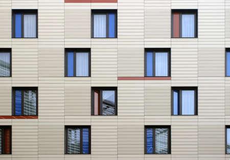 Modern windows mosaic in contemporary modular facade system