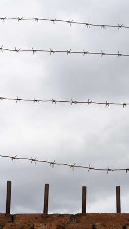 barblock: Fence with barbed wire Stock Photo