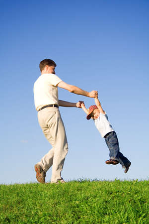 revolve: Young boy play with father Stock Photo